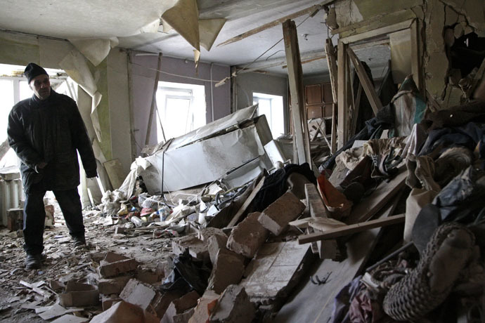 Local resident Nikolai, 82, inspects his apartment, which according to locals, was recently destroyed by shelling, in Donetsk, eastern Ukraine, January 15, 2015. (Reuters/Alexander Ermochenko)