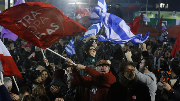 Supporters of radical leftist Syriza party chant slogans and wave Greek national and other flags after winning elections in Athens, January 25, 2015. (Reuters/Alkis Konstantinidis)
