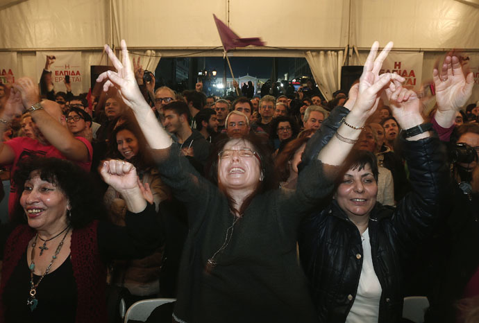 Supporters of radical leftist Syriza party celebrate in Athens January 25, 2015. (Reuters/Yannis Behrakis)