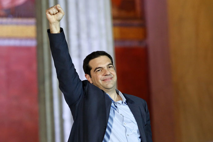 The head of radical leftist Syriza party Alexis Tsipras raises his fist to supporters after winning the elections in Athens January 25, 2015. (Reuters/Giorgos Moutafis)