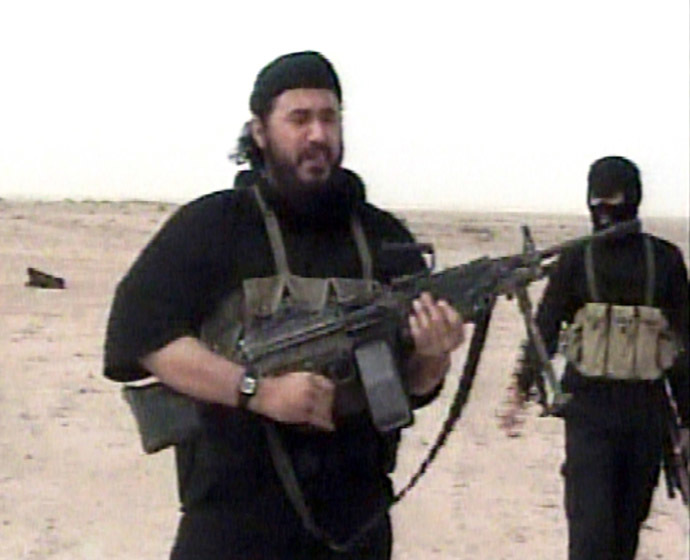 Abu Musab al-Zarqawi (L), leader of al Qaeda in Iraq, is seen in this video footage obtained by the Pentagon and released on May 4, 2006. (Reuters/Department of Defense/Handout)