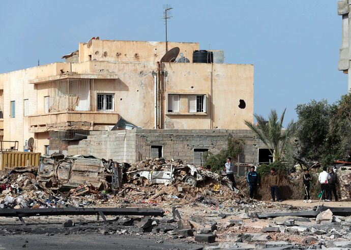 People stand near the site of an explosion in Benghazi February 6, 2015. (Reuters / Esam Omran Al-Fetori)