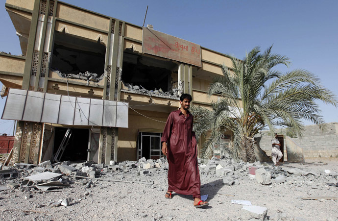 A man walks past the premises of a transport company which the Libyan government said was destroyed by NATO air strikes in Zliten, about 150km (93.2 miles) east of Tripoli July 21, 2011. (Reuters/Ismail Zitouny)