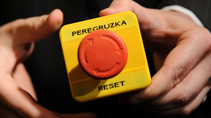 "An assistant shows the mock ""reset"" button which U.S. Secretary of State Hillary Clinton handed to Russia's Foreign Minister Sergei Lavrov during a bilateral meeting in Geneva March 6, 2009. (Reuters/Fabrice Coffrini)"