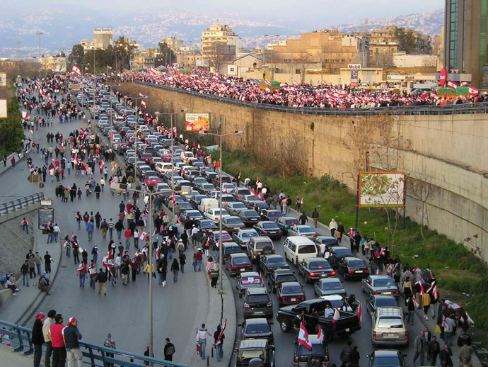 Protesters heading to Martyrs' Square on foot and in vehicles (Photo from wikipedia.org)