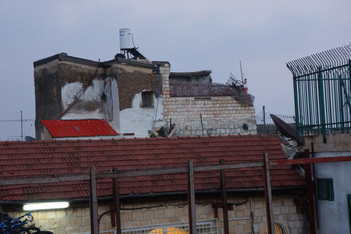 Loai's family defends the territory – their house towers over a block near the al-Aqsa mosque (Photo by Nadezhda Kevorkova)