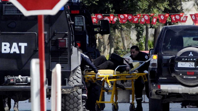 A tourist injured after an attack by gunmen on Tunisia's national museum is wheeled on a stretcher in Tunis March 18, 2015. (Reuters / Stringer)