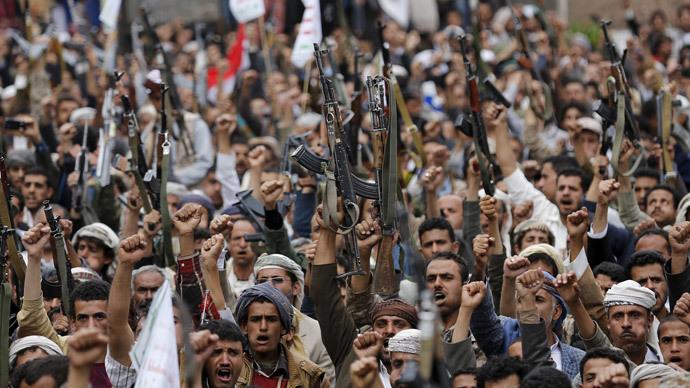 Shi'ite Muslim rebels hold up their weapons during a rally against air strikes in Sanaa March 26, 2015.(Reuters / Khaled Abdullah)