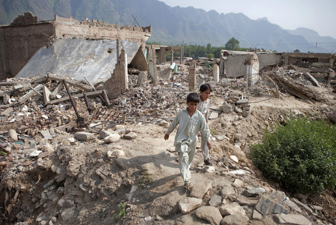 Boys walk through the rubble of destroyed homes in Buner district which is located about 220 km (137 miles) by road northwest of Pakistan's capital Islamabad, September 14, 2009. (Reuters/Faisal Mahmood)