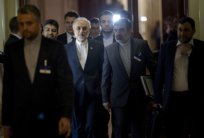 Head of Iranian Atomic Energy Organization Ali Akbar Salehi walks with others during a break in a meeting with world representatives seeking to pin down a nuclear deal with Iran at the Beau Rivage Palace Hotel in Lausanne March 31, 2015 (Reuters / Brendan Smialowski)