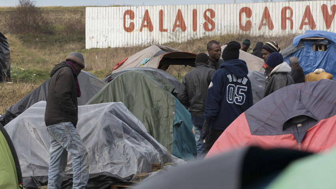 Sudanese migrants gather amongst tents in a camp in Calais. (Reuters/Philippe Wojazer)