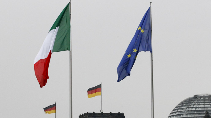 The national flags of Italy and Germany and the EU flag. (Reuters/Tobias Schwarz)