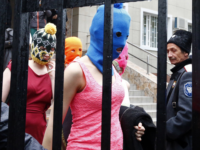Masked members of protest band Pussy Riot leave a police station in Adler during the 2014 Sochi Winter Olympics, February 18, 2014. (Reuters/Shamil Zhumatov)