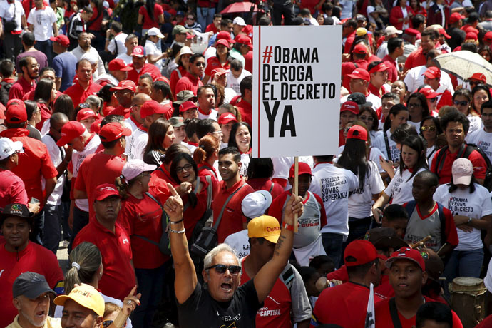 Supporters of Venezuela's President Nicolas Maduro hold a placard and shout during a protest against imperialism, in Caracas March 24, 2015. (Reuters/Carlos Garcia Rawlins)