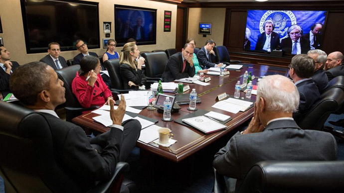 U.S. President Barack Obama (L) receives an update April 1, 2015 in the Situation Room at the White House in Washington from Secretary of State John Kerry during the Iran nuclear talks in this White House handout photo. (Reuters)
