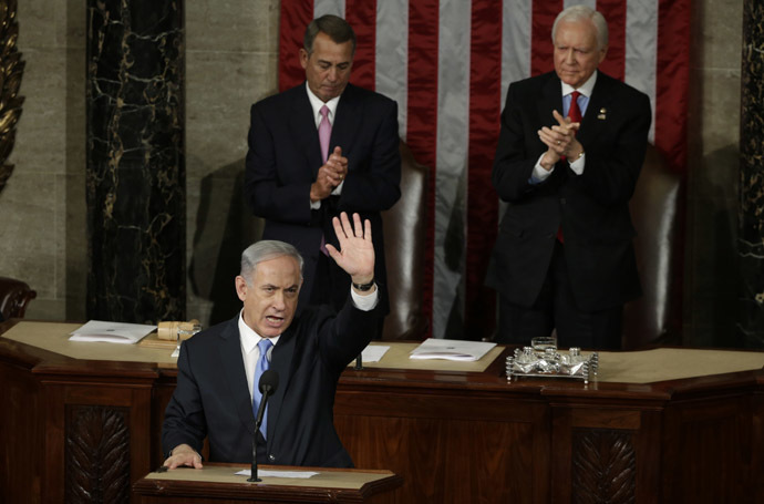 Israeli Prime Minister Benjamin Netanyahu (L) acknowledges applause at the end of his speech to a joint meeting of Congress in the House Chamber on Capitol Hill in Washington, March 3, 2015. (Reuters/Gary Cameron)