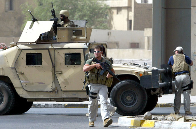 A picture taken on July 5, 2005 shows contractors of the US private security firm Blackwater securing the site of a roadside bomb attack near the Iranian embassy in central Baghdad. (AFP Photo)