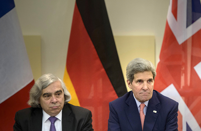 US Secretary of Energy Ernest Moniz (L) and US Secretary of State John Kerry wait for the start of a trilateral meeting at the Beau Rivage Palace Hotel in Lausanne (Reuters / Brendan Smialowski)