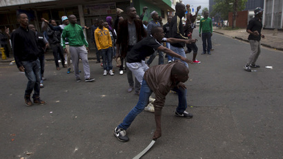 A group of foreign nationals threaten to defend themselves as police get between them and South Africans after a peace march in Durban, April 16, 2015. (Reuters/Rogan Ward)