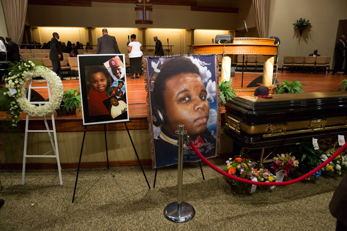 Photos surround the casket of Michael Brown at Friendly Temple Missionary Baptist Church in St. Louis, Missouri, August 25, 2014. (Reuters / Richard Perry / Pool)