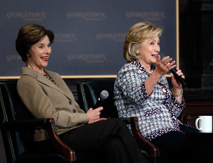 Former U.S. Secretary of State Hillary Clinton (R) and former first lady Laura Bush (Reuters / Jason Reed)