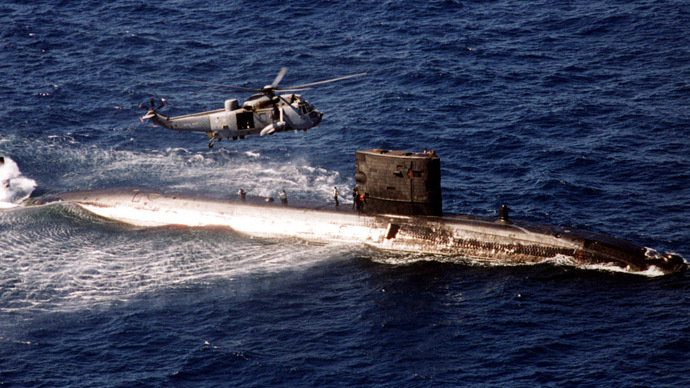 "A Sea King helicopter from HMS Invincible meets nuclear powered Trafalgar class ""hunter killer"" submarine HMS Turbulent in the Ionian Sea (Reuters)"
