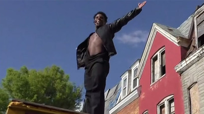 'Just chillax and think': Dancing Michael Jackson impersonator to Baltimore protesters