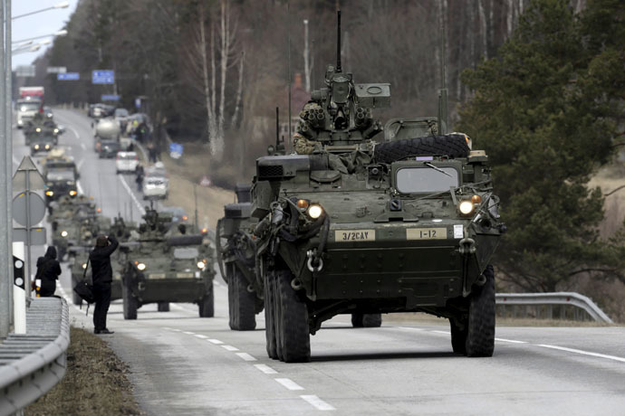 "Soldiers of the U.S. Army 2nd Cavalry Regiment deployed in Estonia as a part of the U.S. military's Operation Atlantic Resolve, during the ""Dragoon Ride"" exercise move past Liepupe March 22, 2015. (Reuters/Ints Kalnins)"