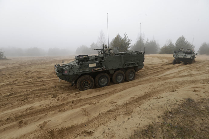 "Soldiers of the U.S. Army's 2nd Cavalry Regiment, deployed in Latvia as part of NATO's Operation Atlantic Resolve, ride in armored vehicles named ""Stryker"" during a joint military exercise in Adazi February 26, 2015. (Reuters/Ints Kalnins)"