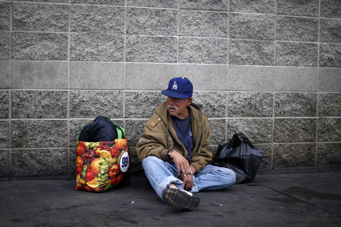 Homeless U.S. army Vietnam War veteran Frank Victor, 63, smokes a cigarette on skid row in Los Angeles on Veterans Day, California (Reuters/Lucy Nicholson)