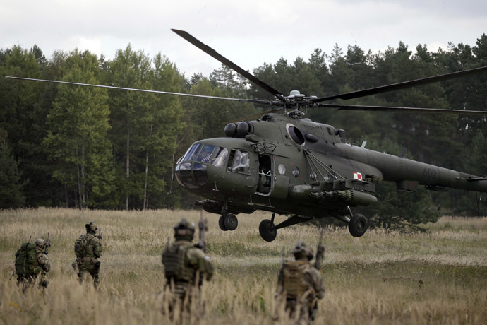 "A Mi-17 helicopter lands during the ""Noble Sword-14"" NATO international tactical exercise at the land forces training centre in Oleszno, near Drawsko Pomorskie, northwest Poland. (Reuters/Kacper Pempel)"