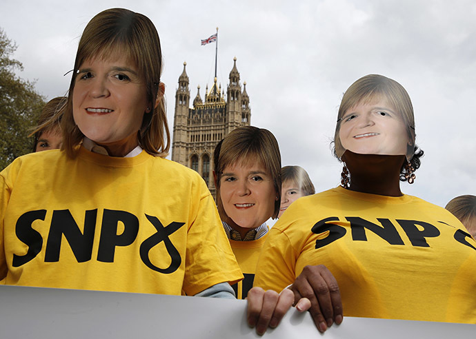 Conservative Party activists wear face masks of Scottish National party leader Nicola Sturgeon during a stunt outside the Houses of Parliament, in central London, Britain, May 1, 2015. (Reuters/Peter Nicholls)