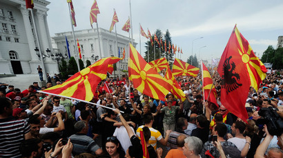 Protesters wave Macedonian and Albanian flags during an anti-government demonstration in front of the government building in Skopje, Macedonia, May 17, 2015.(Reuters / Ognen Teofilovski)