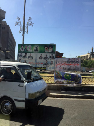 Photos of Martyrs in the fight against ISIS adorn the streets of Baghdad (Photo by Eisa Ali)