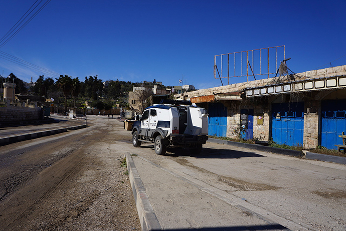Military hardware in the empty streets near the Israeli settlement entrance (Photo by Nadezhda Kevorkova)