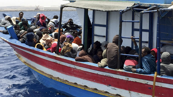 Illegal migrants who attempted to sail to Europe, sit in a boat carrying them back to Libya, after their boat was intercepted at sea by the Libyan coast guard, at Khoms, Libya May 6, 2015. (Reuters/Aymen Elsahli)