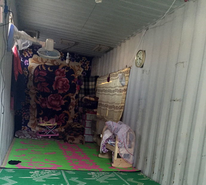 The home of a displaced family on the Najaf-Karbala highway. Their newborn daughter sleeps in the wooden cot. Photo by Eisa Ali