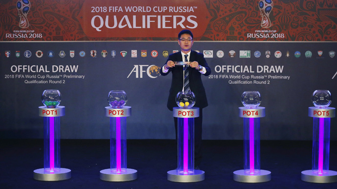 Asian Football Confederation's Shin Man Gil draws Afghanistan for Group E in the 2018 FIFA World Cup Asian qualifiers during the preliminary joint qualification round 2 draw in Kuala Lumpur, April 14, 2015. (Reuters / Olivia Harris)