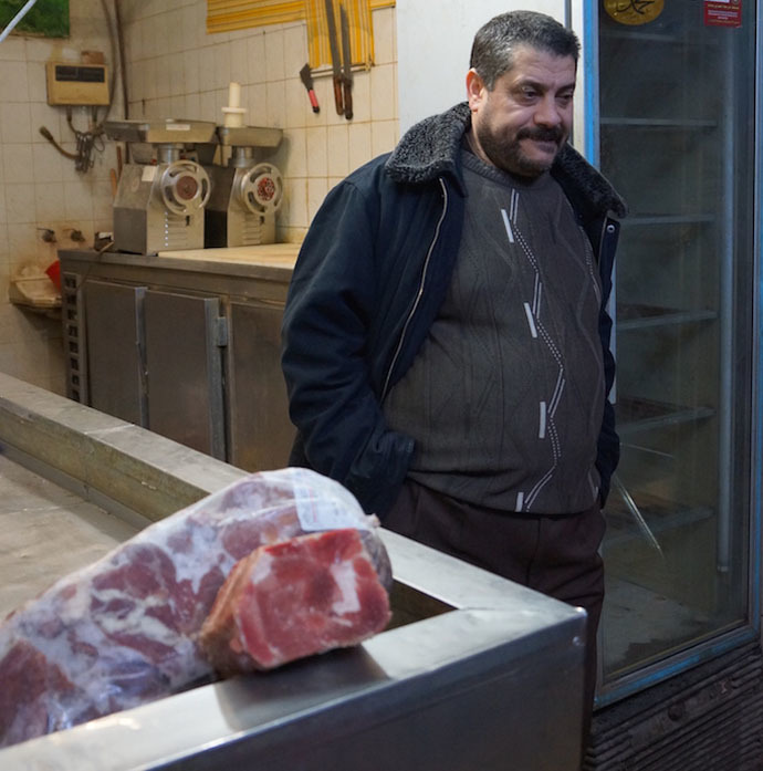 Usama in his butcher shop (Photo by Nadezhda Kevorkova)