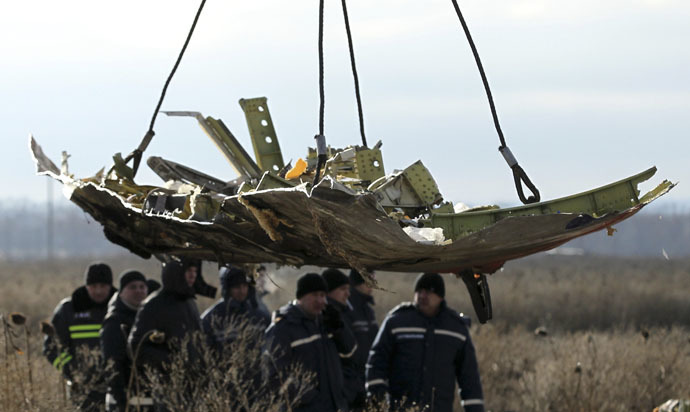 A crane transports a piece of the Malaysia Airlines flight MH17 wreckage at the site of the plane crash near the village of Hrabove (Grabovo) in Donetsk region, eastern Ukraine November 20, 2014. (Reuters/Antonio Bronic)