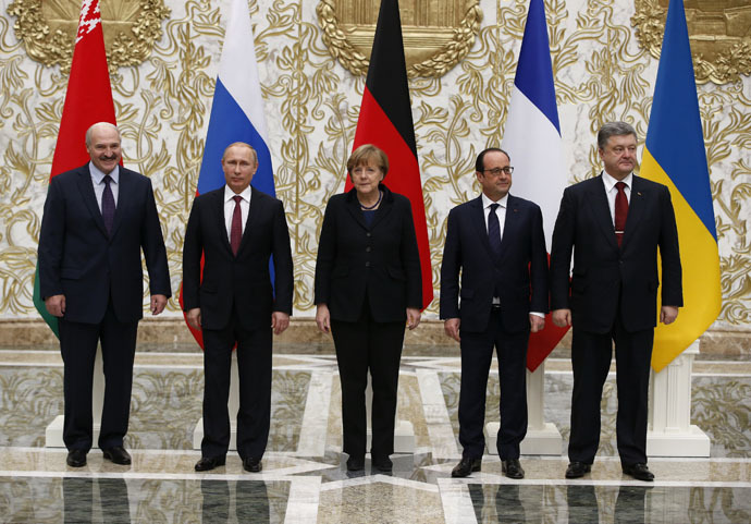 Belarus' President Alexander Lukashenko (L), Russia's President Vladimir Putin (2nd L), Ukraine's President Petro Poroshenko (R), Germany's Chancellor Angela Merkel (C) and France's President Francois Hollande pose for a family photo during peace talks in Minsk, February 11, 2015. (Reuters/Grigory Dukor)