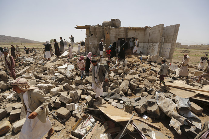 People gather on the rubble of houses destroyed by a Saudi-led air strike near Yemen's capital Sanaa June 3, 2015. (Reuters/Khaled Abdullah)