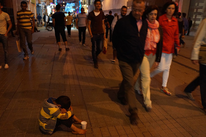 """He just wants money,"" passers-by were saying, pointing at a barefooted boy on the most expensive street in Istanbul"