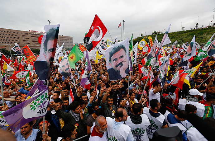 Supporters of the Pro-Kurdish Peoples' Democratic Party (HDP) wave flags with a picture the jailed Kurdish militant leader Abdullah Ocalan, during a gathering to celebrate their party's victory during the parliamentary election, in Istanbul, Turkey, June 8, 2015 (Reuters / Murad Sezer)