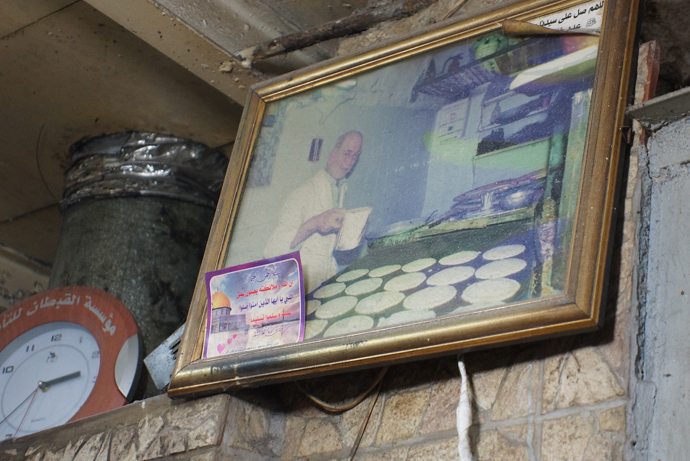 A photo of Ghazi's father on the wall. He was a cook (photo by Nadezhda Kevorkova)