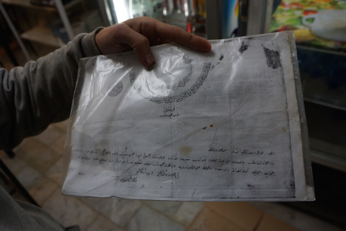 A copy of documents to the property. If the family fail to pay taxes, they will lose the restaurant (photo by Nadezhda Kevorkova)
