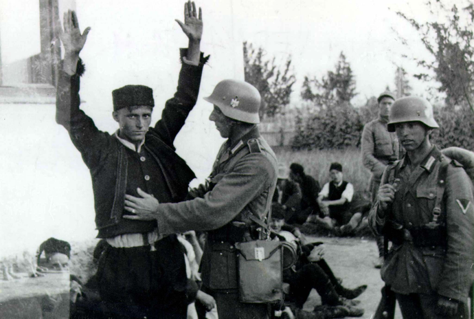 FILE PHOTO: Hitler's Wehrmacht soldier checks a Bosnian Moslem in Sarajevo in 1941 after Wehrmacht troops arrived in Bosnia. (Reuters)