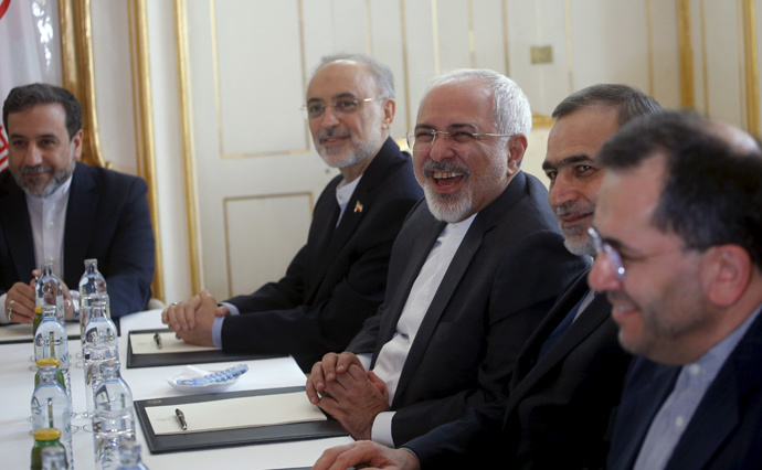 Iranian Foreign Minister Javad Zarif (C) laughs during a meeting with U.S. Secretary of State John Kerry (not pictured) at a hotel in Vienna, Austria June 30, 2015. (Reuters / Carlos Barria)