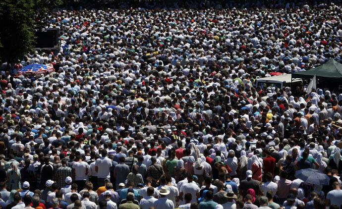 People attend a reburial ceremony of 136 newly identified victims in Potocari, near Srebrenica, Bosnia and Herzegovina July 11, 2015. (Reuters/Stoyan Nenov)