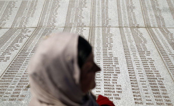 A woman stands in front of the Memorial Center during a reburial ceremony of 136 newly identified victims in Potocari, near Srebrenica, Bosnia and Herzegovina July 11, 2015. (Reuters/Antonio Bronic)